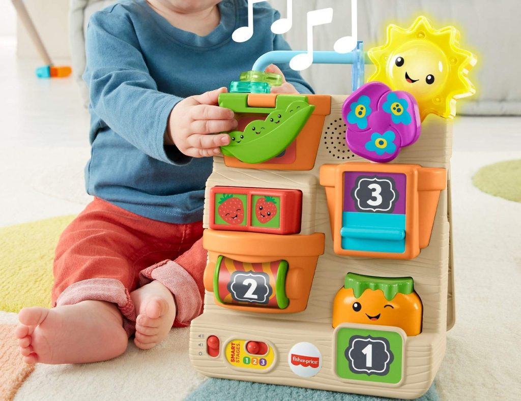 fisher price busy garden kid playing with