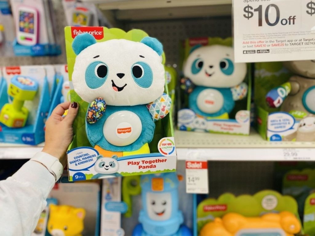 hand holding fisher-price play together panda