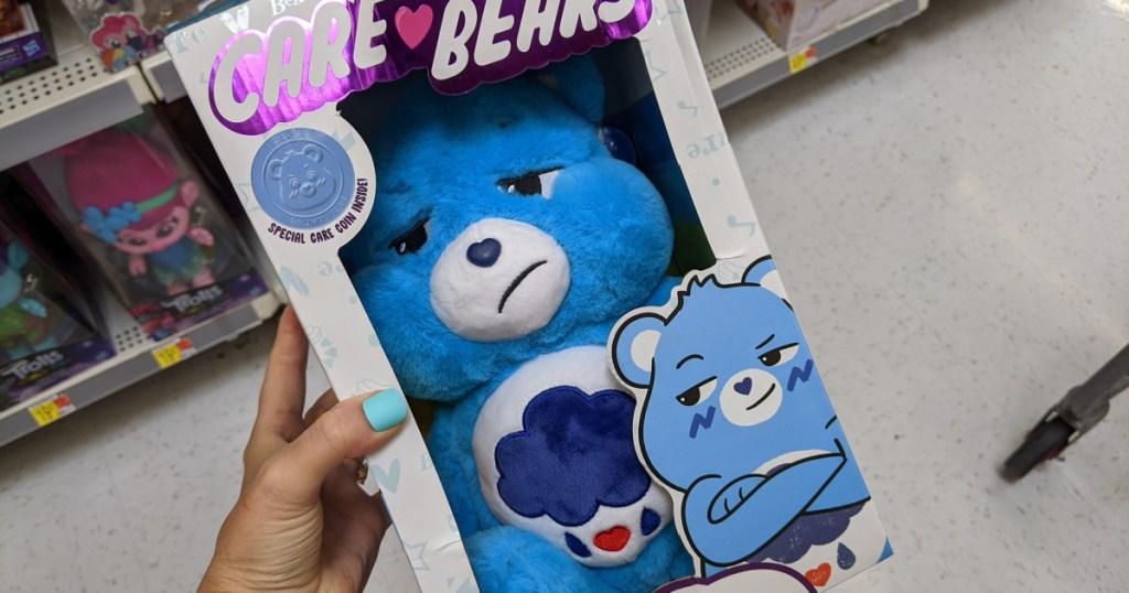 grumpy bear care bear in hand in store
