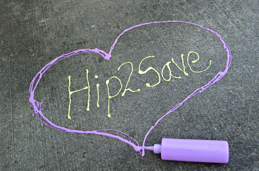 Hip2Save painted on sidewalk inside heart