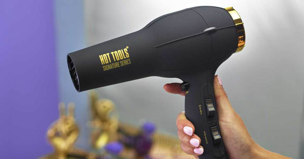 hand holding blow dryer