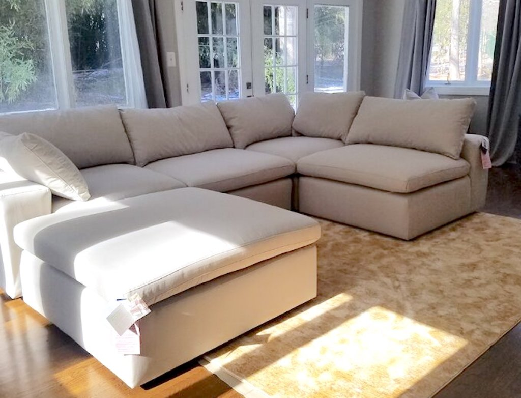 beige sectional sofa in room with windows and doors