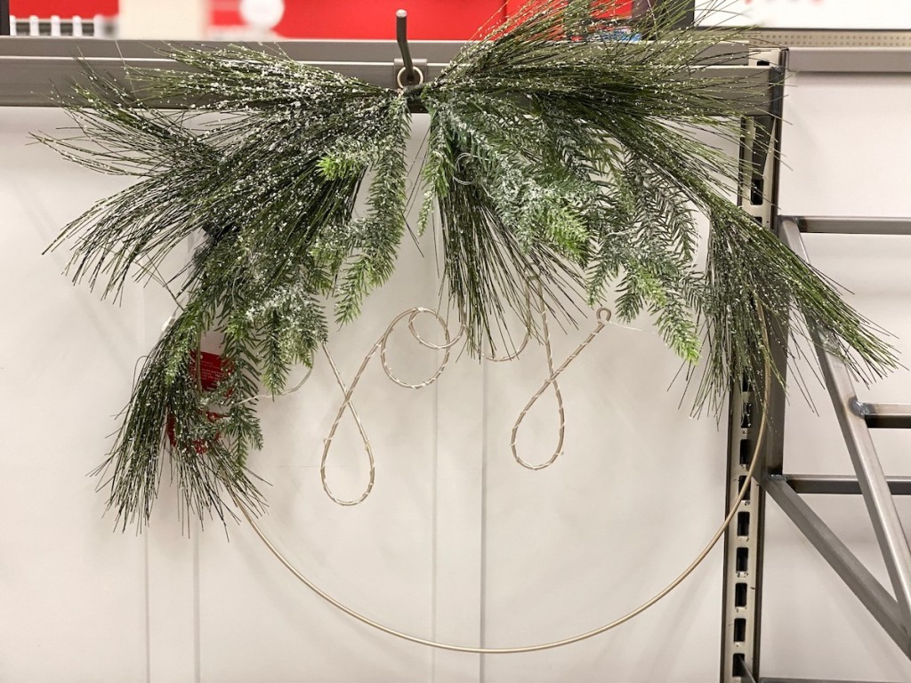 joy wreath hanging on store shelf