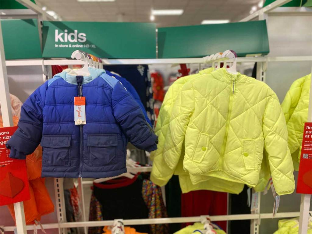kids jackets hanging on display in store
