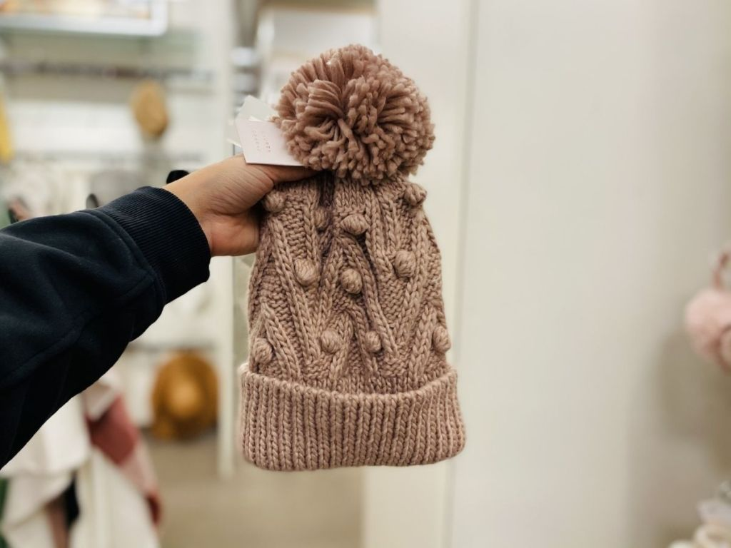 hand holding pink stitch beanie