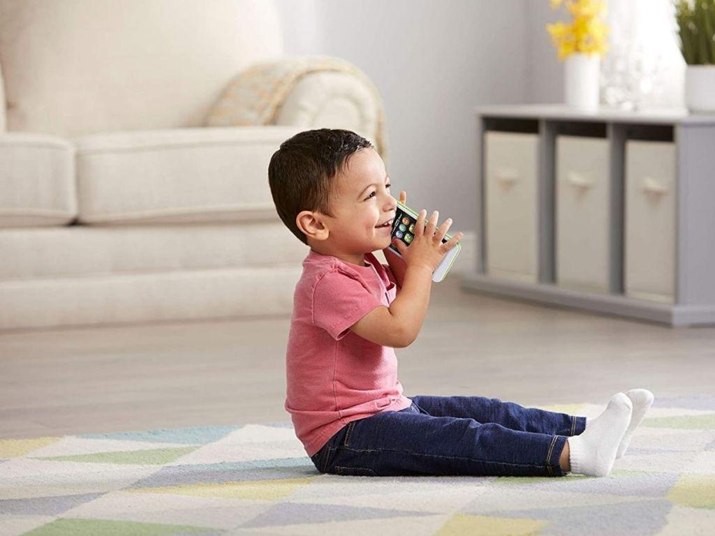 boy using Leapfrog phone