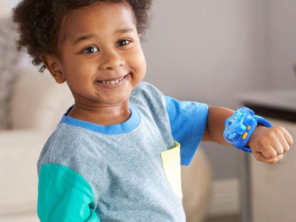 boy wearing blue LeapFrog watch