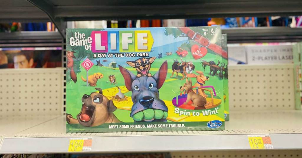 hand holding a board game with dogs on it