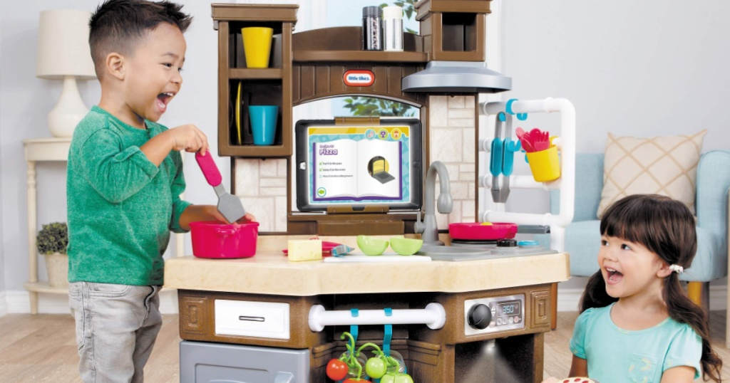 kids playing with little tikes smart kitchen