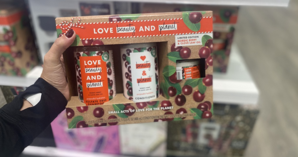 hand holding love beauty and planet holiday set at target