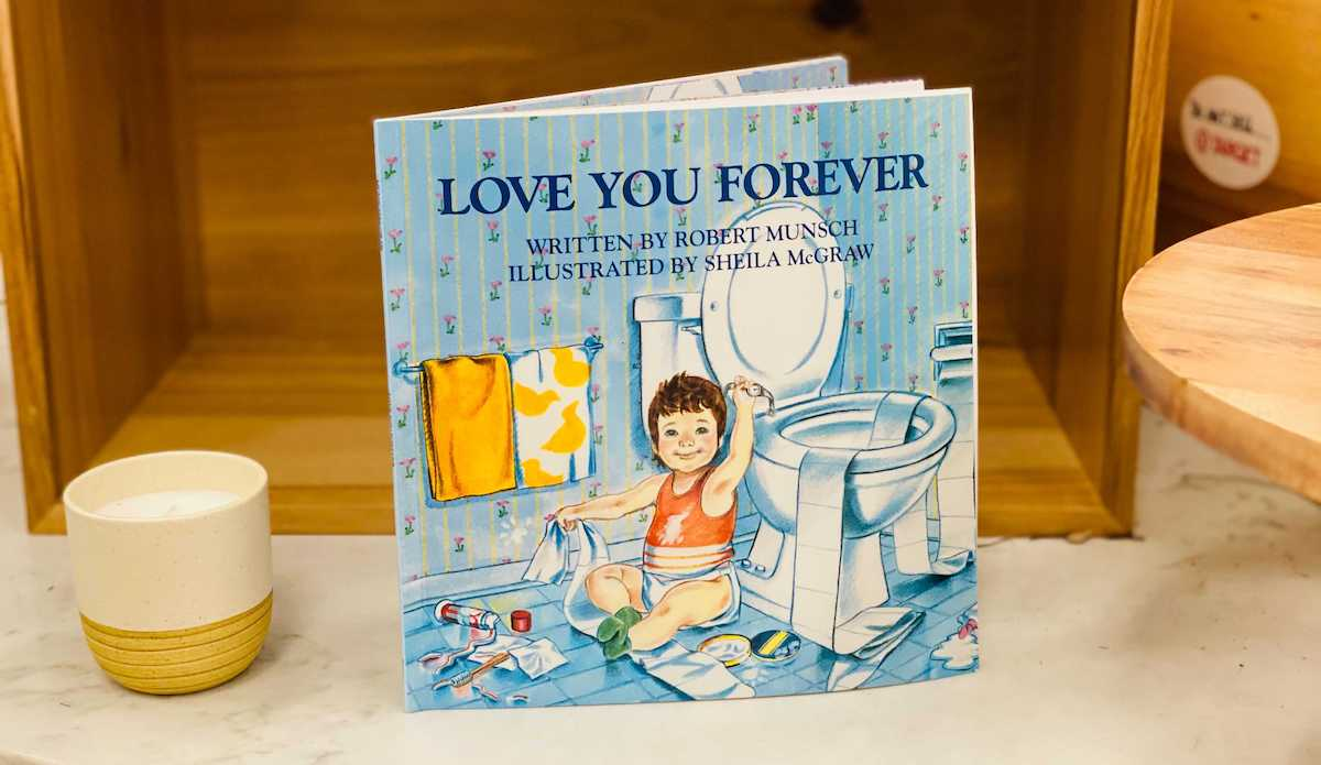 love you forever book standing on marble tabletop kids books gifts