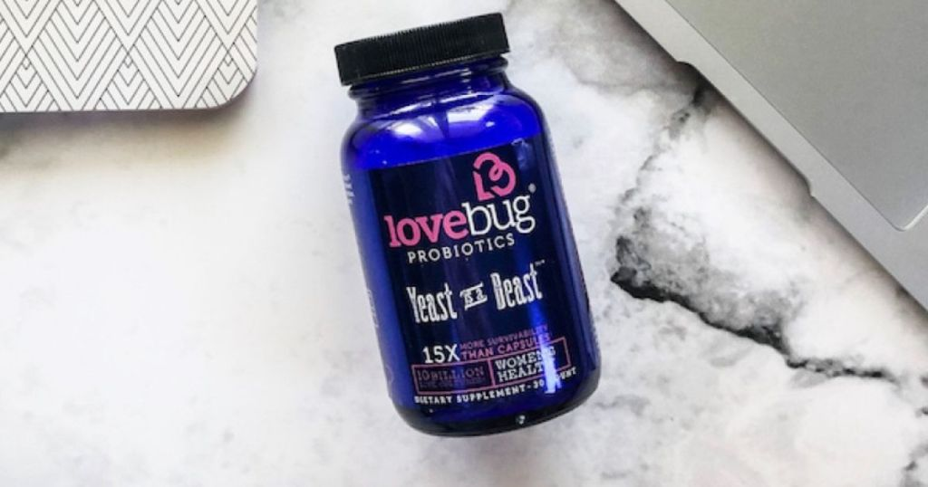 LoveBug Yeast is a Beast pill bottle on marble surface
