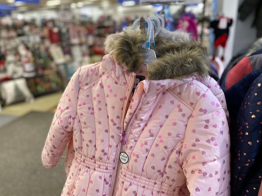pink heart kids jacket hanging in store