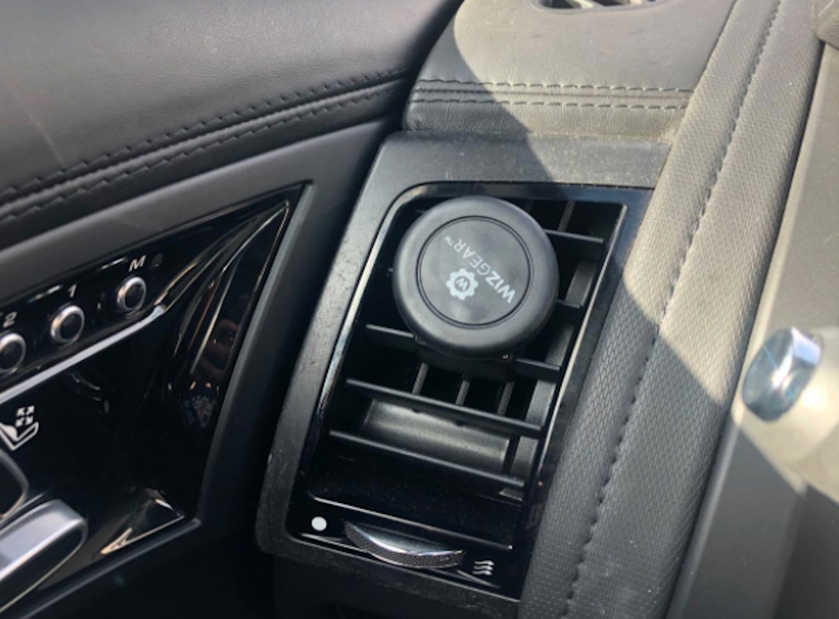interior car vent with round magnet on vent