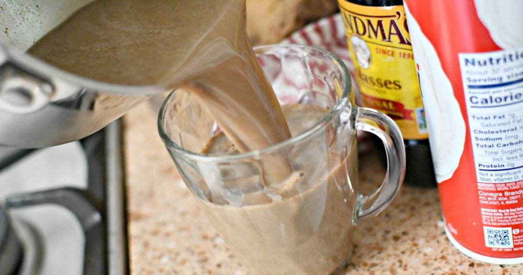 making homemade gingerbread latte on the stove