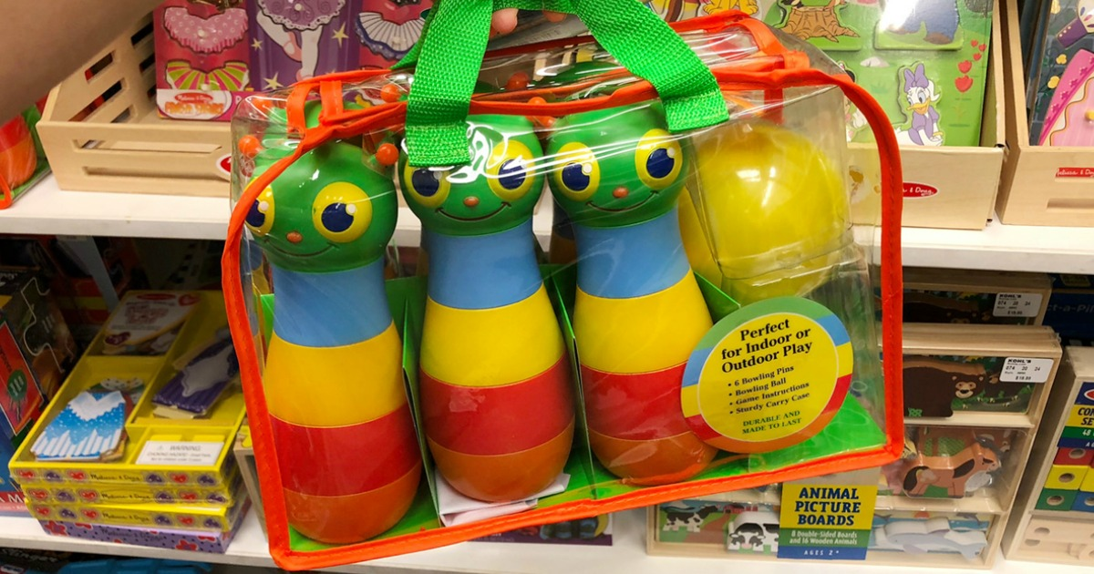 melissa and doug bowling set in package being held up in store
