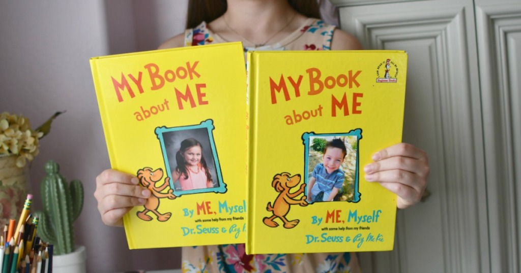 girl holding two my book about me dr suess books