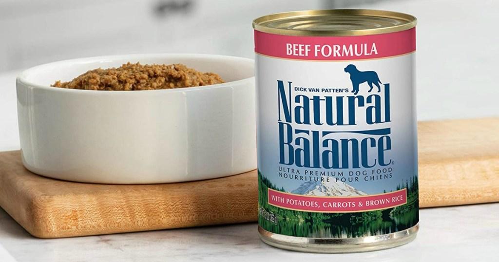 natural balance dog food can next to a bowl of dog food