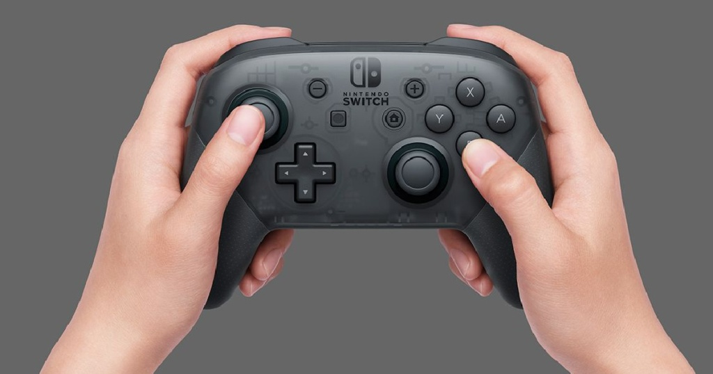 nintendo switch controller black in hands