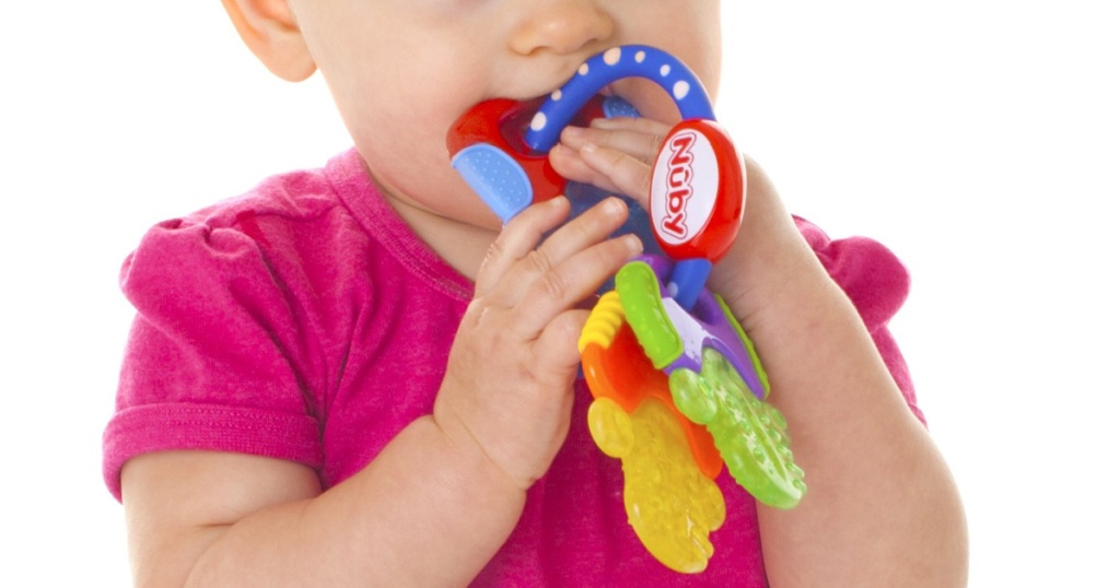 nuby baby teether in baby mouth