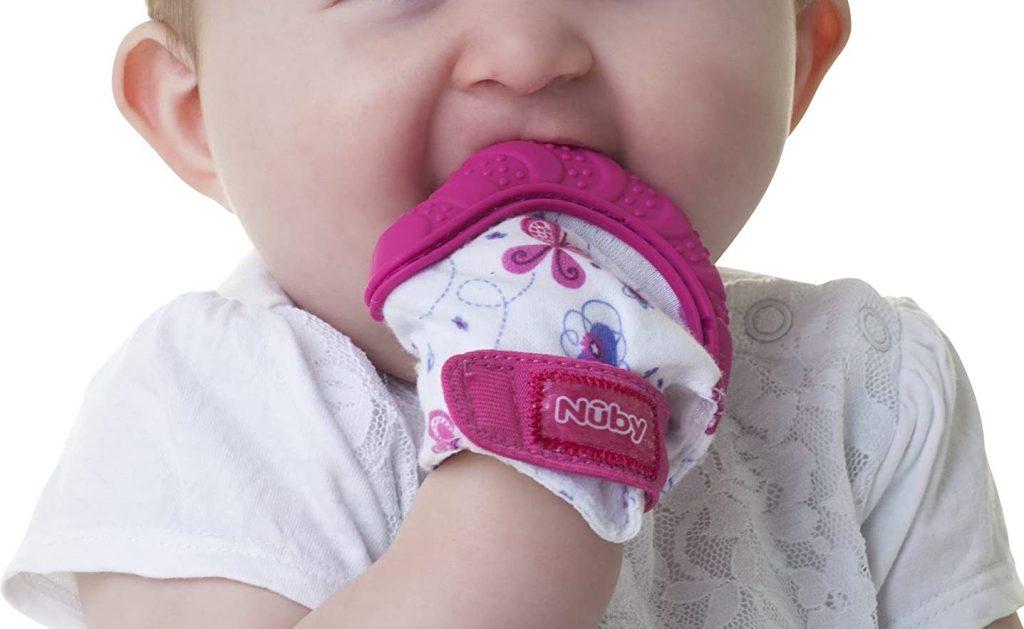 nuby mitten in babys mouth