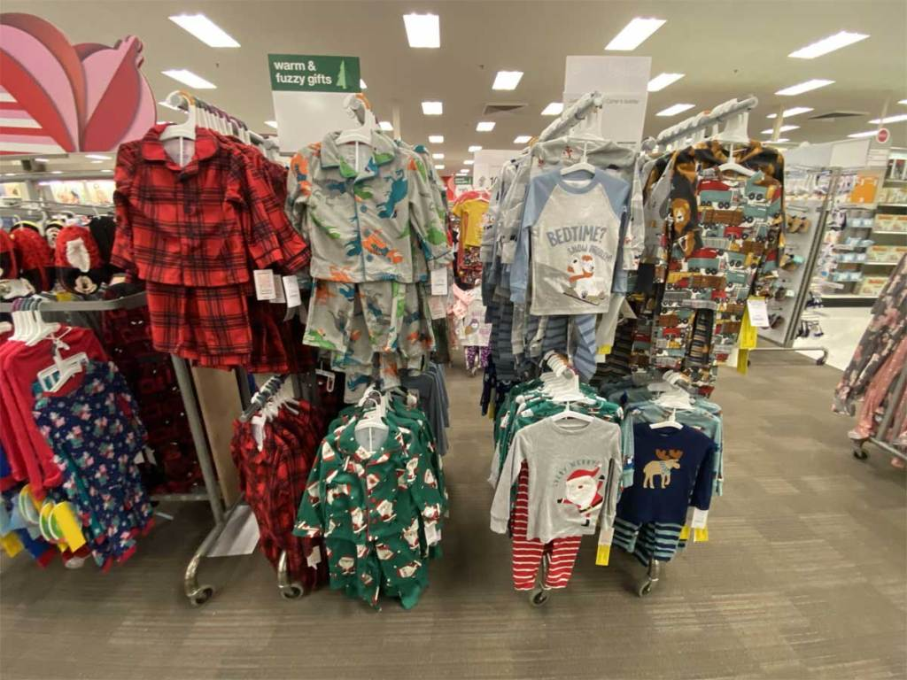 pajama sets hanging up on display in store