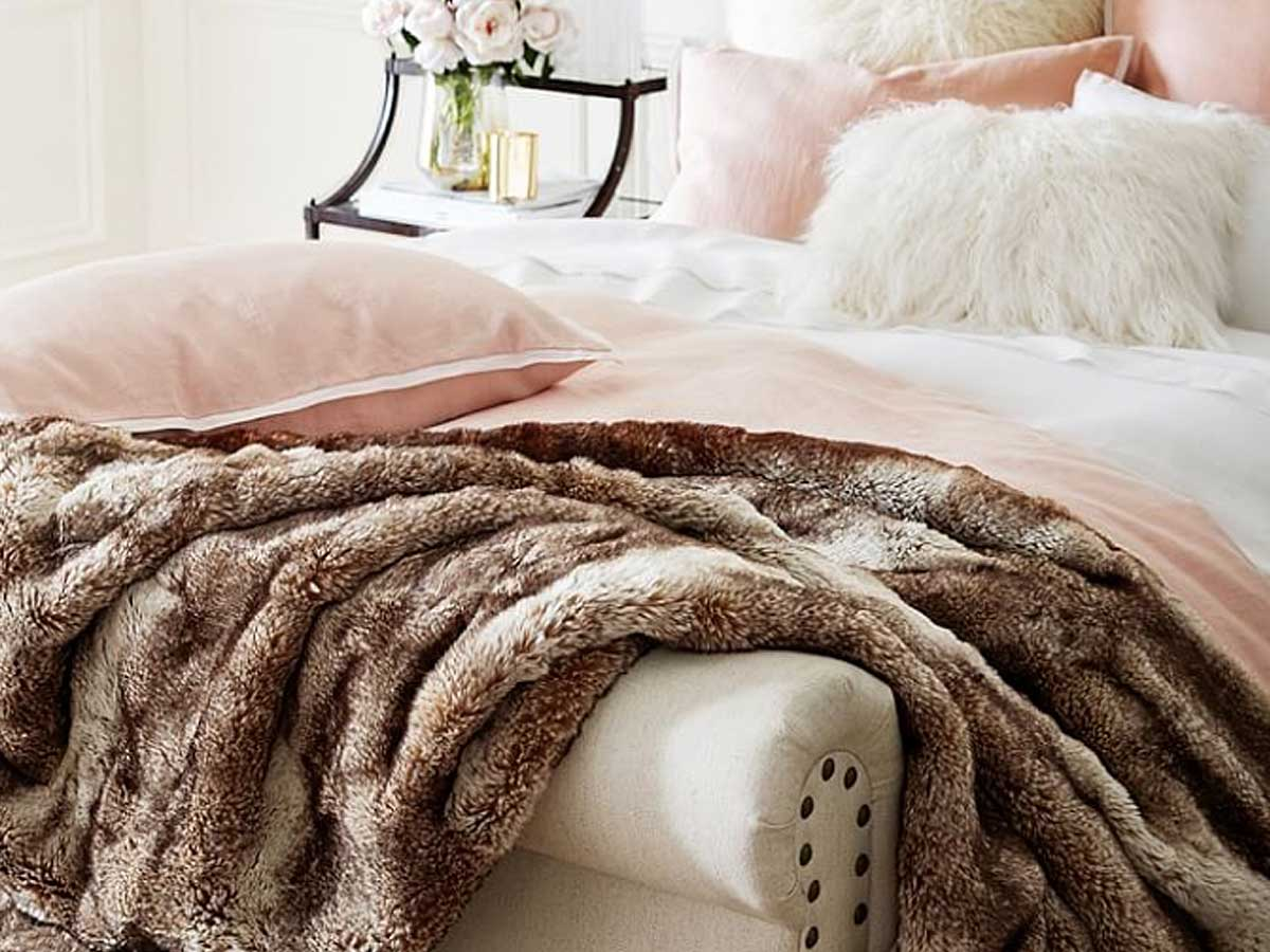 faux fur throw on bed