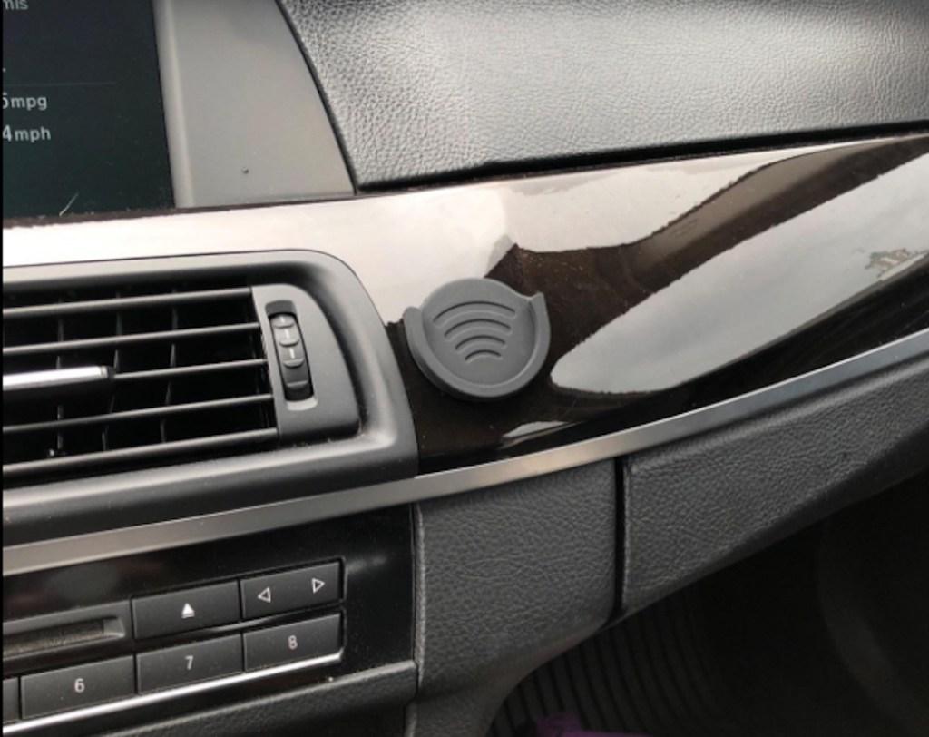 popsocket mount on car dashboard