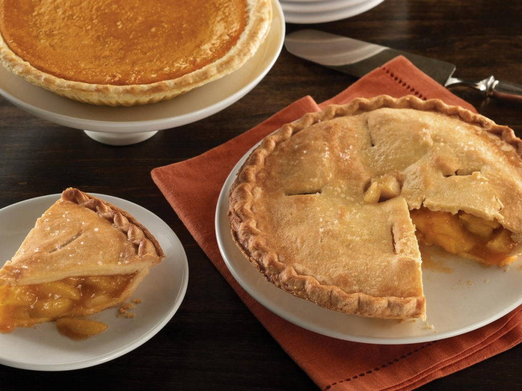 pumpkin and apple pie on table