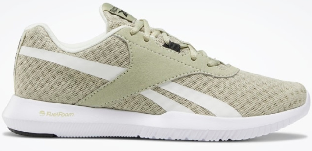 green and white Reebok shoes