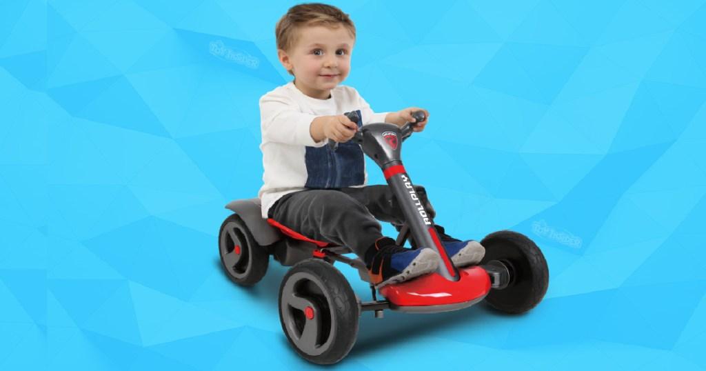 little boy on rollplay ride on vehicle toy