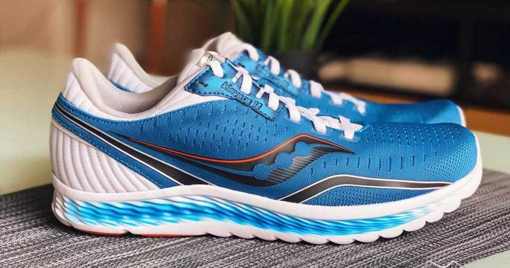 men's running shoes on a table