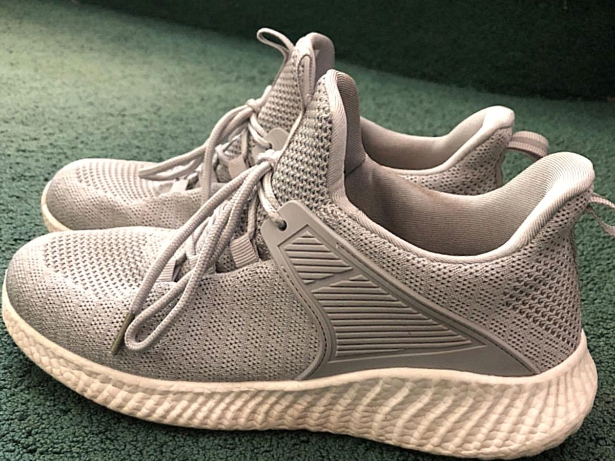 gray mesh running shoes with white sole