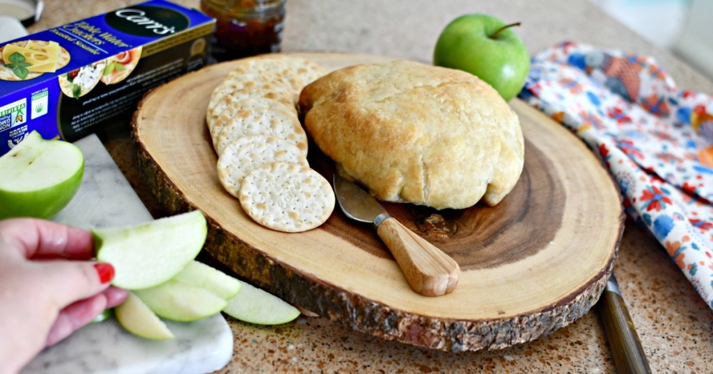 serving baked brie with crackers and apples