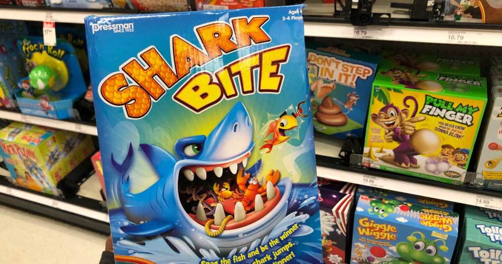 shark bite game being held up in a store