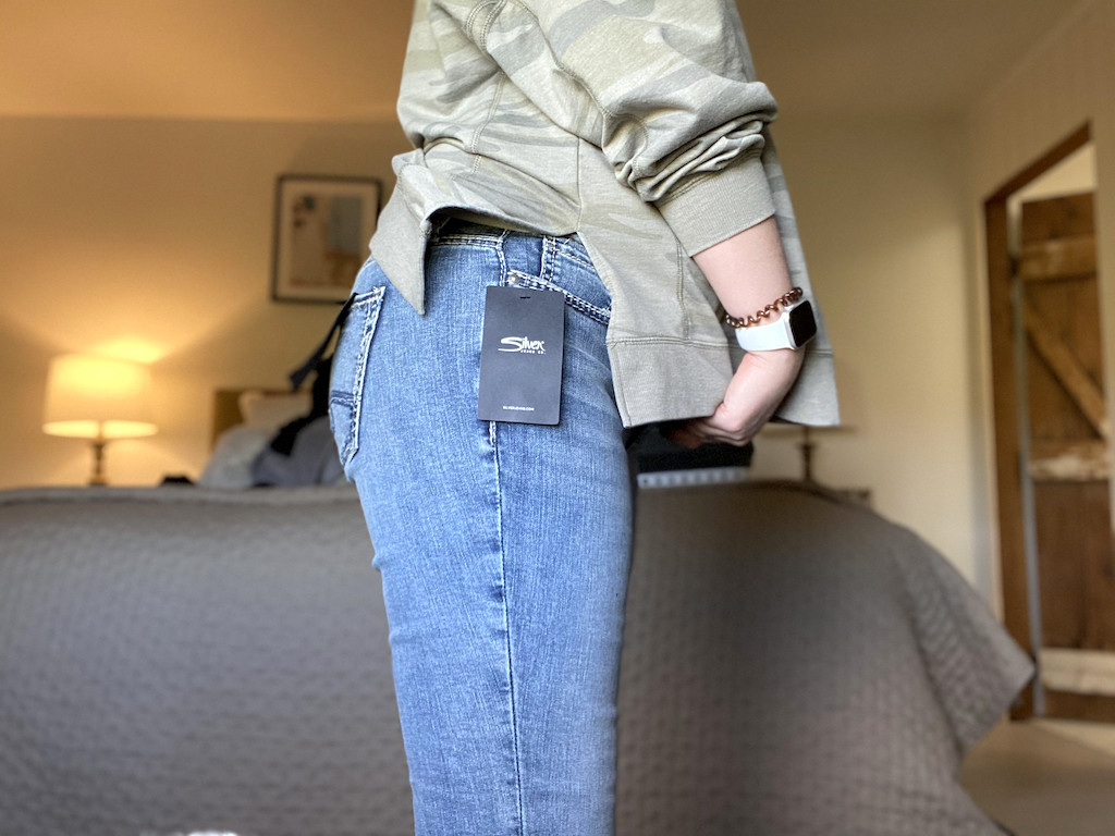 woman with Silver jeans on and camo shirt