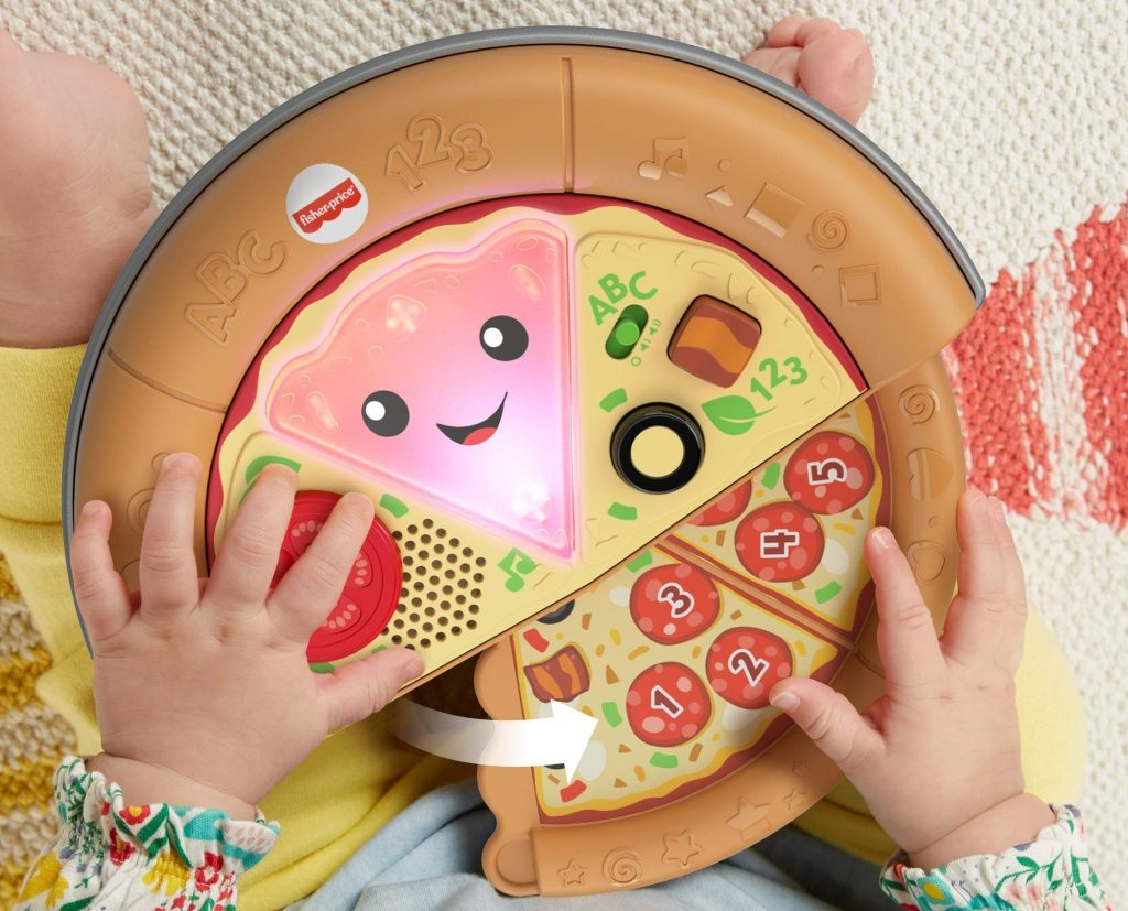 fisher price slice of learning pizza in baby hands