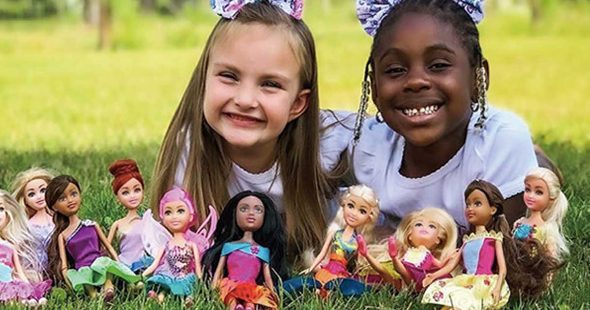 two young girls playing outside with sparkl dolls
