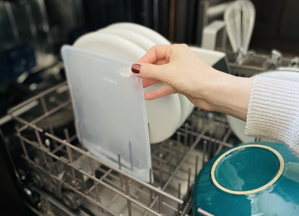 hand holding stasher bag in dishwasher rack