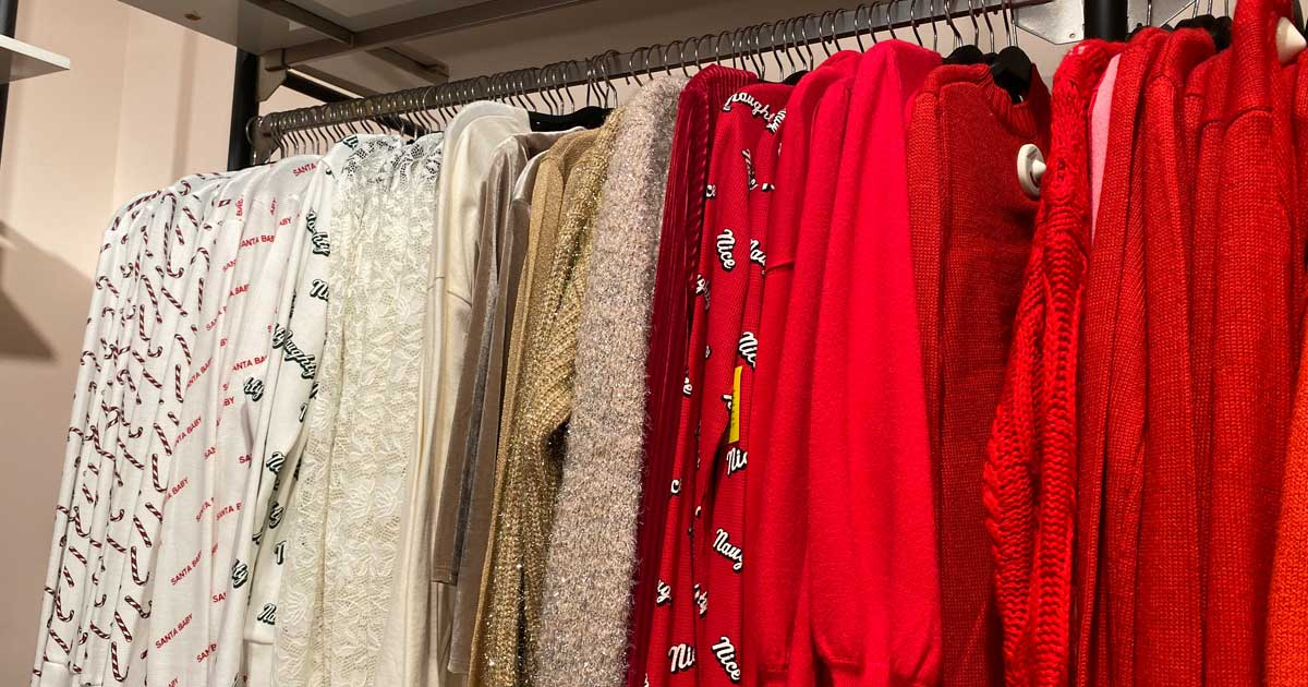 sweaters on hangers in a store