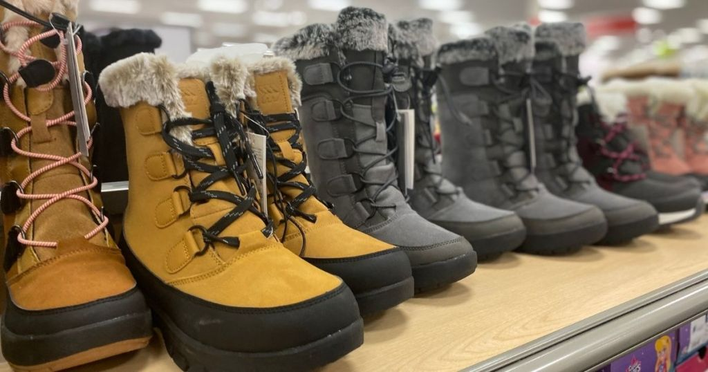 tan and black boots on display at store