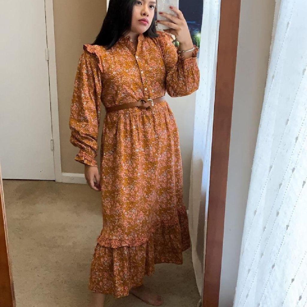 Woman taking selfie in prairie dress