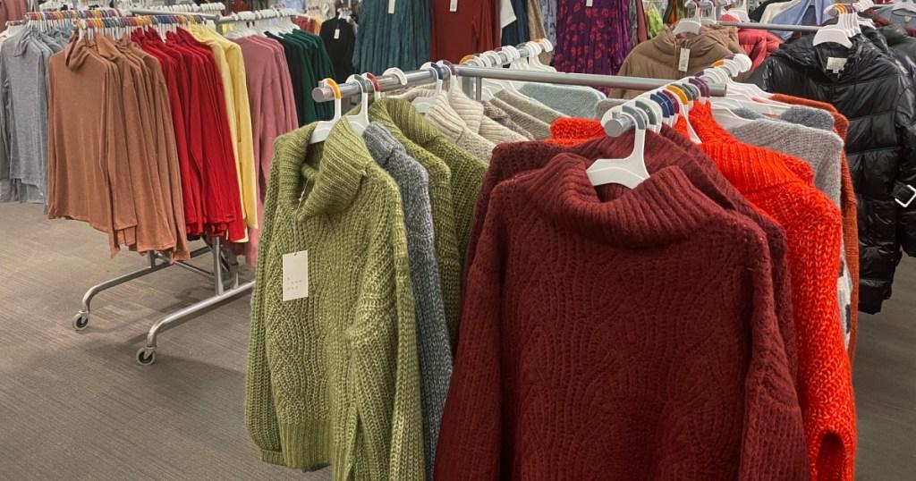 target sweaters hanging on racks in store