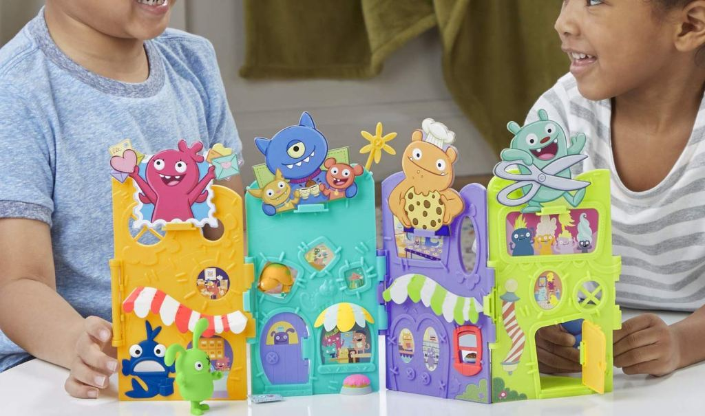 kids playing with uglydolls playset