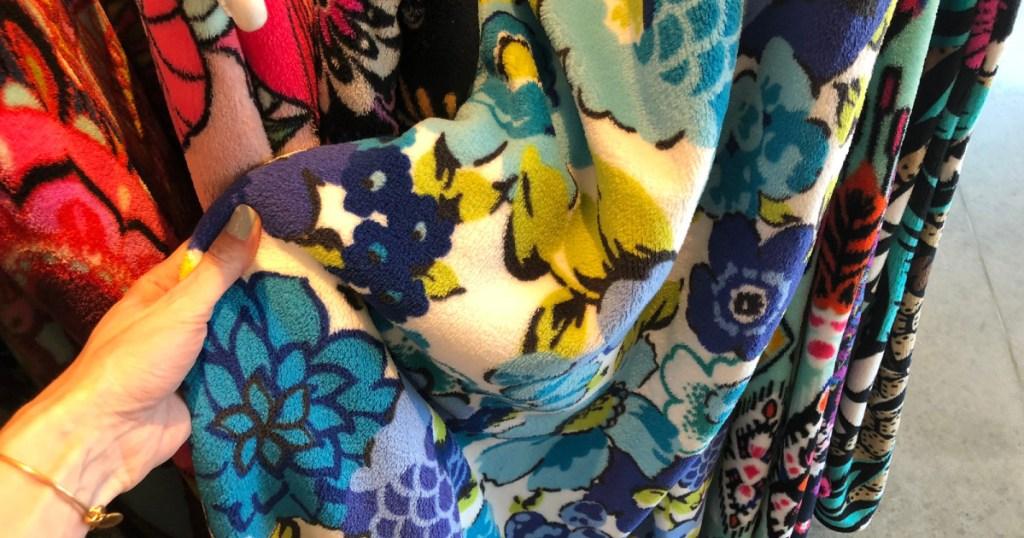 vera bradley plush blanket in hand in store