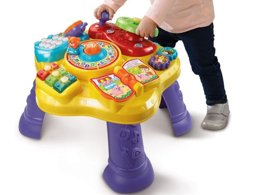 toddler using play table