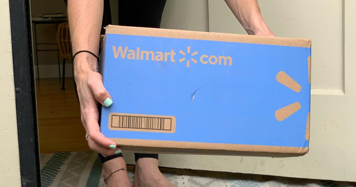 woman holding Walmart box