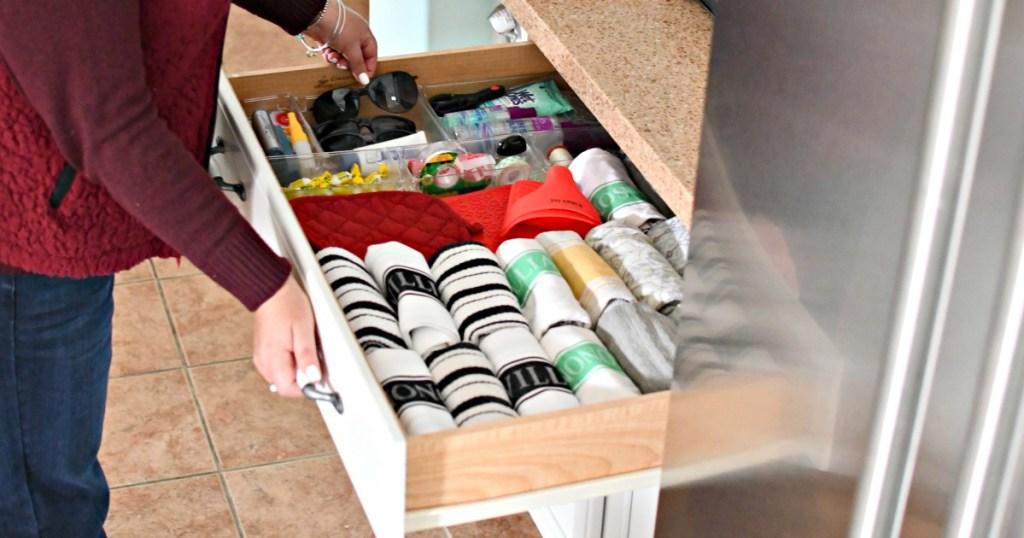 woman opening junk drawer