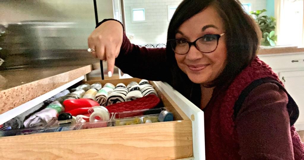 woman organizing junk drawer