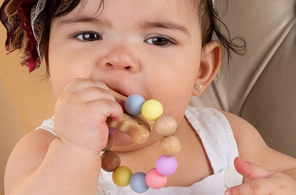 wooden teethers in baby mouth